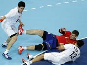 Julen Aguinagalde of Spain, center, and Lee Jae-woo (13) and Park Jung-geu of South Korea challenge during their men`s handball preliminary match at the 2012 Summer Olympics.