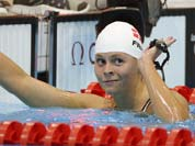 Denmark`s Lotte Friis gestures after competing in a women`s 800-meter freestyle swimming heat at the Aquatics Centre in the Olympic Park during the 2012 Summer Olympics in London.
