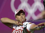Russia`s Ksenia Perova shoots during the individual archery competition at the 2012 Summer Olympics.
