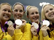 Australia`s women`s 4 X 200-meter freestyle relay team from left, Kylie Palmer, Alicia Coutts, Bronte Barratt, and Melanie Schlanger pose with their silver medals at the Aquatics Centre in the Olympic Park during the 2012 Summer Olympics.
