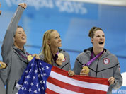 From right, United States` Missy Franklin, United States` Dana Vollmer, United States` Allison Schmitt and United States` Shannon Vreeland pose with their gold medals for the women`s 4x200-meter freestyle relay swimming final at the Aquatics Centre in the Olympic Park during the 2012 Summer Olympics