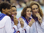 From right, France`s Camille Muffat, France`s Charlotte Bonnet, France`s Ophelie-Cyrielle Etienne and France`s Coralie Balmy pose with their bronze medals for the women`s 4x200-meter freestyle relay swimming final at the Aquatics Centre in the Olympic Park during the 2012 Summer Olympics.