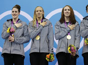 From left, United States` Missy Franklin, United States` Dana Vollmer, United States` Shannon Vreeland and United States` Allison Schmitt pose with their gold medals for the women`s 4x200-meter freestyle relay swimming final at the Aquatics Centre in the Olympic Park during the 2012 Summer Olympics.