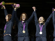 Italy`s gold medalists Elisa Di Francisca, left to right, Arianna Errigo, Valentina Vezzali and Ilaria Salvatori celebrate after defeating Russia in the gold medal match at women`s team foil fencing at the 2012 Summer Olympics.