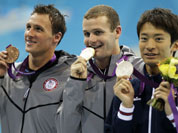 Japan`s Ryosuke Irie, United States` Tyler Clary and United States` Ryan Lochte pose with their medals for the men`s 200-meter backstroke swimming final at the Aquatics Centre in the Olympic Park during the 2012 Summer Olympics in London.