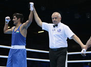 Vijender, left, reacts after defeating the United States` Terrell Gausha in a men`s middle weight 75-kg boxing match at the 2012 Summer Olympics.