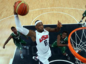 Lebron James of the United States (6) shoots against Tony Skinn (4) and Al-Farouq Aminu (7) of Nigeria during their men`s basketball preliminary round match at the 2012 Summer Olympics.