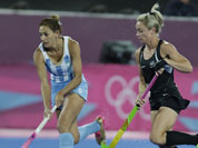 Argentina`s captain Luciana Aymar runs with the ball during a women`s hockey preliminary round match against New Zealand, at the 2012 Summer Olympics.