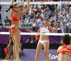 Olympic beach volleyball stars can't keep their hands off each other at match