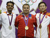Gold medalist, Cuba`s Leuris Pupo, center poses for a picture with silver medalist, India`s Vijay Kumar, and bronze medalist, China`s Zhang Jian during the victory ceremony for the men`s 25-meter rapid fire pistol event at the 2012 Summer Olympics, in London.