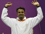 Vijay Kumar reacts as he mounts the medals podium to receive a silver for the men`s 25-meter rapid fire pistol event at the 2012 Summer Olympics in London.
