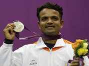 Vijay Kumar reacts displays his silver medal, during the victory ceremony for the men`s 25-meter rapid fire pistol event at the 2012 Summer Olympics in London.