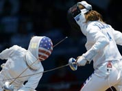 United States` Susie Scanlan, left, competes against Italy`s Nathalie Moellhausen during women`s team epee fencing at the 2012 Summer Olympics.