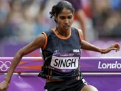 Sudha Singh jumps during a heat of the women`s 3000-meter steeplechase during the athletics in the Olympic Stadium at the 2012 Summer Olympics.