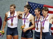 US rowers, from right, Scott Gault, Charles Cole, Henrik Rummel and Glenn Ochal celebrate after winning the bronze medal for the men`s rowing four in Eton Dorney, near Windsor, at the 2012 Summer Olympics.