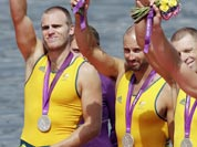 Australia`s from right, Joshua Dunkley-Smith, Drew Ginn, James Chapman and William Lockwood celebrate after winning the silver medal for the men`s rowing four in Eton Dorney, near Windsor, at the 2012 Summer Olympics.