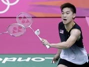 Malaysia`s Koo Kien Keat, left, and Tan Boon Heong, play against China`s Cai Yun and Fu Haifeng, unseen, at a men`s doubles badminton semifinal match of the 2012 Summer Olympics.