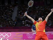 China`s Fu Haifeng, left, and Cai Yun celebrate after beating Koo Kien Keat and Tan Boon Heong, of Malaysia, in a men`s doubles badminton semifinal match at the 2012 Summer Olympics.