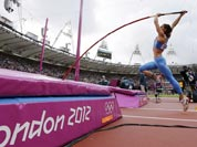 Russia`s Yelena Isinbayeva practices ahead of the women`s pole vault qualification during the athletics in the Olympic Stadium at the 2012 Summer Olympics.