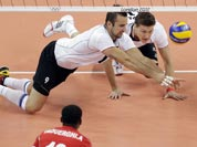 Germany`s Gyorgy Grozer (9, left) and Lukas Kampa (11) dive for a shot by Tunisia`s Anouer Taouerghi (12) during a men`s volleyball preliminary match at the 2012 Summer Olympics.