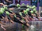 New Zealand`s Nicky Samuels dives into the water for the start of the triathlon at the 2012 Summer Olympics.