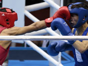 India`s Devendro Singh Laishram, left, and Mongolia`s Serdamba Pureverdorj, fight during the men`s light flyweight boxing competition at the 2012 Summer Olympics.