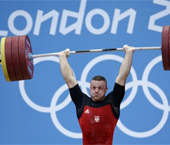 Olympic weightlifting: Polish underdog bags gold