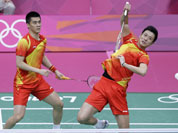 China`s Cai Yun, and Fu Haifeng play against Malaysia`s Koo Kien Keat and Tan Boon Heong, unseen, at a men`s doubles badminton semifinal match of the 2012 Summer Olympics in London.
