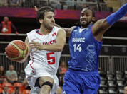 Tunisia`s Marouan Laghnej, looks to pass as he drives past France`s Ronny Turiaf during a men`s basketball game at the 2012 Summer Olympics in London.