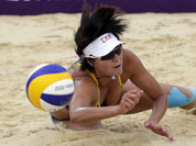 Zhang Xi of China dives for the ball during a beach volleyball match against Russia at the 2012 Summer Olympics in London.
