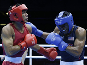 India`s Krishan Vikas, left, fights United States` Errol Spence during a men`s welterweight 69-kg preliminary boxing match at the 2012 Summer Olympics.