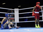 Devendro Singh Laishram of India, right, knocks down Serdamba Purevdorj of Mongolia, during their fight at the men`s light flyweight boxing at the 2012 Summer Olympics.