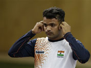 dia`s Vijay Kumar removes his ear plugs at the end of the men`s 25-meter rapid fire pistol final at the 2012 Summer Olympics, Friday, Aug. 3, 2012, in London. Kumar finished second to win the silver.
