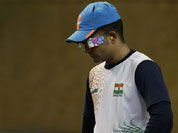 India`s Vijay Kumar prepares to shoot during the men`s 25-meter rapid fire pistol final at the 2012 Summer Olympics, Friday, Aug. 3, 2012, in London. Kumar finished second to win the silver.