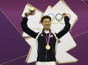 Gold medal winner, South Korea`s Jin Jong-oh, right, celebrates with countryman Choi Young-rae, who took silver, during the victory ceremony for the men`s 50-meter pistol, at the 2012 Summer Olympics.