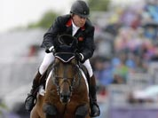 Nick Skelton, of Great Britain, rides Big Star, during the equestrian show jumping competition at the 2012 Summer Olympics.