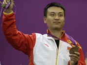 China`s Wang Zhiwei reacts after receiving the bronze medal for the men`s 50-meter pistol, at the 2012 Summer Olympics.