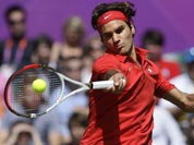 Switzerland`s Roger Federer returns a shot to Britain`s Andy Murray during the men`s singles gold medal match at the All England Lawn Tennis Club at Wimbledon, in London, at the 2012 Summer Olympics.