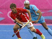 Sardar Singh, right and South Korea`s Lee Nam-yong vie for the ball their men`s hockey preliminary round match against Pakistan at the 2012 Summer Olympics.