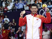 China`s Lin Dan, right, shows his gold medal after winning the men`s singles badminton gold medal match defeating Malaysia`s Lee Chong Wei, left, at the 2012 Summer Olympics.