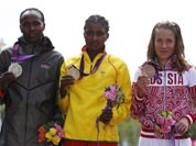 Ethiopia`s Tiki Gelana is flanked by Kenya`s silver medal winner Priscah Jeptoo, left, and Russia`s bronze medalist Tatyana Petrova Arkhipova during the ceremony for the women`s marathon at the 2012 Summer Olympics.