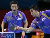Singapore`s Jian Zhan, right, and Zi Yang compete against a team from China in the men`s team quarterfinals table tennis match at the 2012 Summer Olympics.