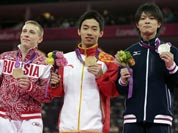 Russian bronze medallist Denis Ablyazin, left, Chinese gold medallist Zou Kai, center, and Japanese silver medallist Kohei Uchimura display their medals during the podium ceremony for the men`s floor exercise finals at the 2012 Summer Olympics.
