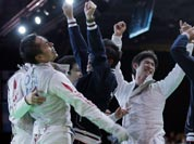 Team Japan celebrate beating Germany to advance to the finals during the men`s foil team fencing competition at the 2012 Summer Olympics.