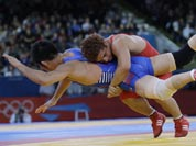 Cuba`s Gustavo Balart, right, takes South Korea`s Choi Gyu-jin to the mat 55-kg Greco-Roman wrestling competition at the 2012 Summer Olympics.
