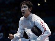 Ryo Miyake of Japan reacts during his match against Ma Jianfei of China in the men`s foil team fencing competition at the 2012 Summer Olympics.