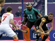 Belgium`s John-John Dohmen (7) tries to score a goal as New Zealand`s Bradley Shaw (12) defends during their men`s hockey preliminary match at the 2012 Summer Olympics.