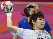 South Korea`s Jung Ji-hae shoots in front of Sweden`s Isabelle Gullden, during their women`s handball preliminary match at the 2012 Summer Olympics.