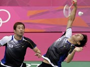 South Korea`s Lee Yong-dae, right, and Chung Jae-sung play against Malaysia`s Koo Kien Keat and Tan Boon Heong in the men`s doubles badminton bronze medal match at the 2012 Summer Olympics.