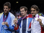 From right, silver medalist Switzerland`s Roger Federer, gold medalist Andy Murray of Great Britain, and bronze medalist Juan Martin del Potro of Argentina pose after the medal ceremony of the men`s singles event at the All England Lawn Tennis Club at Wimbledon, in London, at the 2012 Summer Olympic
